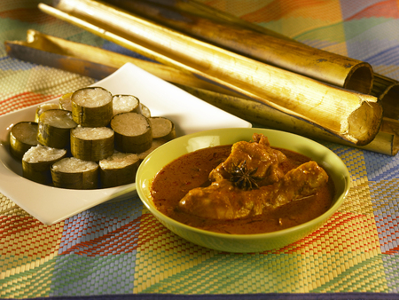 malay traditional food, lemang with curry chicken Stock Photo - 121509617