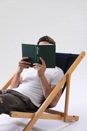 man reading book Stock fotó