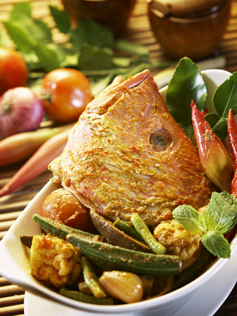 curry fish head with garnishing Stock Photo