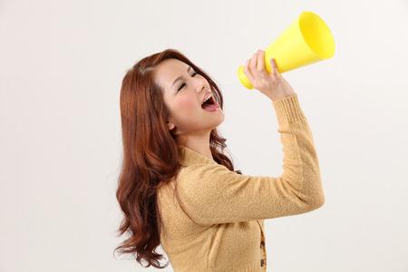 Woman screaming into bullhorn