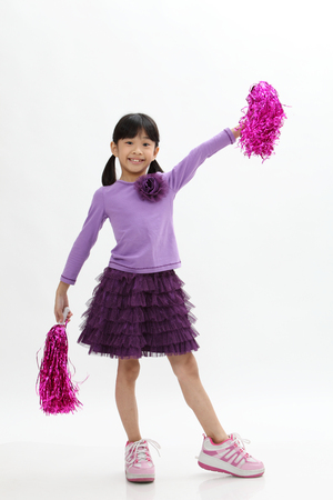 chinese girl holding pom pom Stock Photo