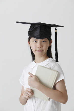 chinese girl wearing a mortar board
