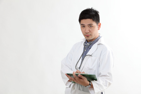 half length chinese doctor with the clip board