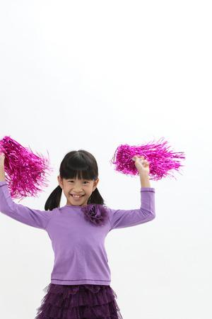 Happy chinese girl holding pom pom Stock Photo