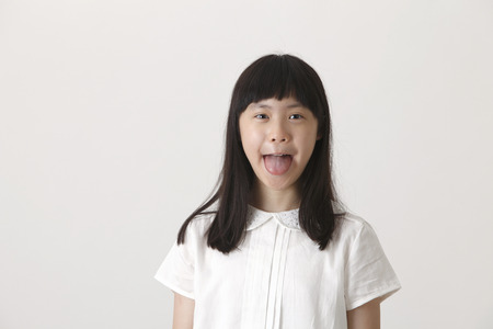 naughty chinese girl making funny face