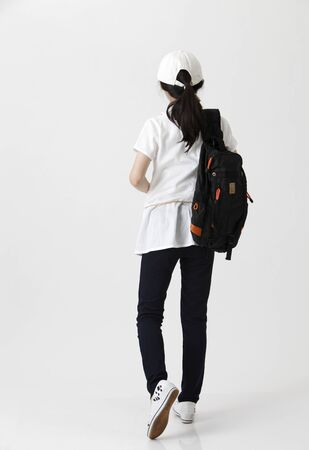 rear view of girl with backpack Imagens