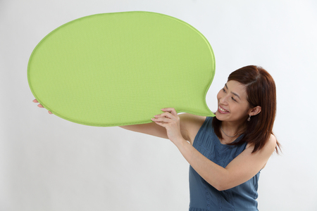 chinese woman holding a speech bubble