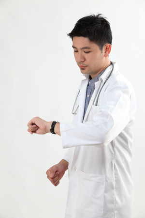 chinese doctor looking at the watch