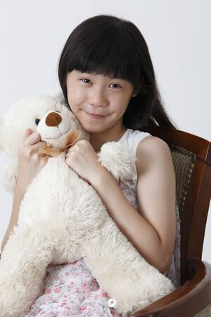 Chinese girl hugging soft toy