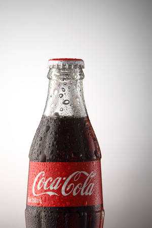 KUALA LUMPUR, MALAYSIA - june 6TH, 2015. A bottle of Coca Cola soft drinks. Coca Cola drinks are produced and manufactured by The Coca-Cola Company, an American multinational beverage corporation