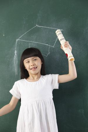 girl holding certificate in front of blackboard 版權商用圖片