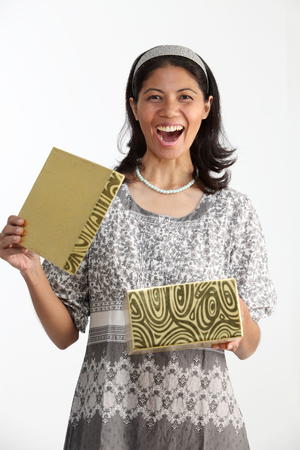 woman holding present box with surprise