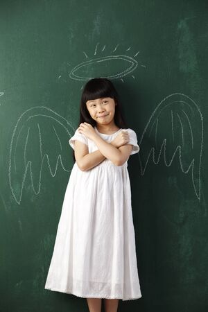 chinese girl  in front of blackboard