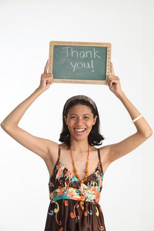 Malay woman holding a blackboard written thank you Imagens