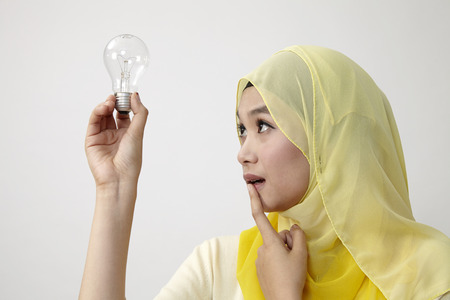 malay woman holding a lightbulb