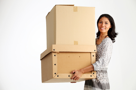 malay woman lifting two cardboxes