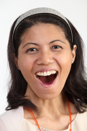 close up portrait of malay woman laughing Imagens