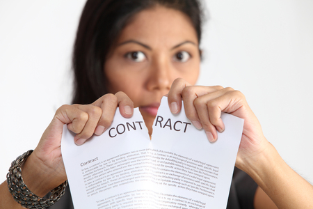 malay woman tearing the contract