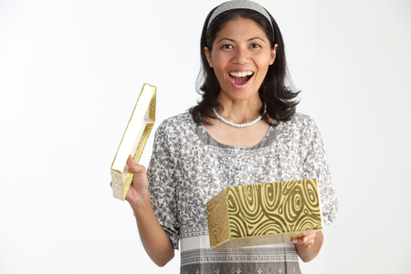 Malay woman holding present box with surprise Imagens