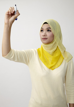 malay woman holding a marker pen