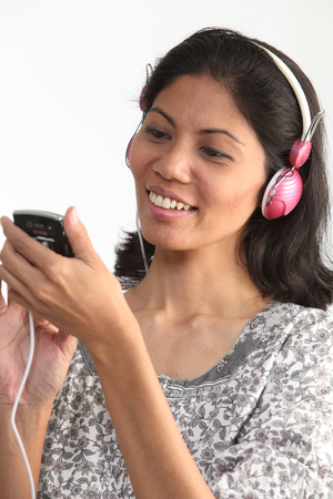 woman selecting music from hand phone