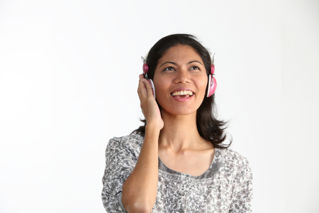 woman singing while listening to the music
