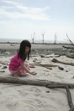 child playing at the polluted beaxh