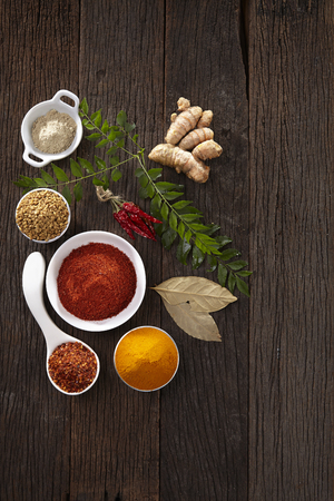 assorted spices on the wooden background Stock Photo