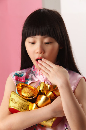 girl  holding holding and looking at ingot surprise