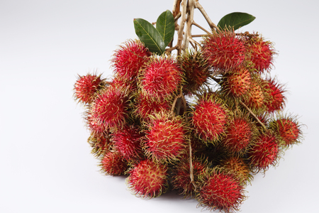 asian fruit rambutan on the plain background Stock Photo