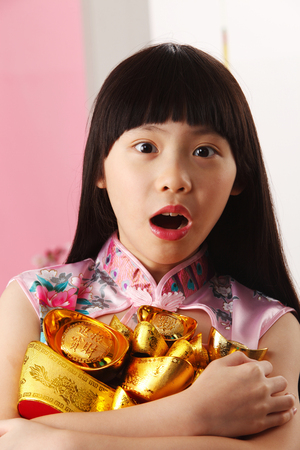 girl holding gold ingot with surprise look