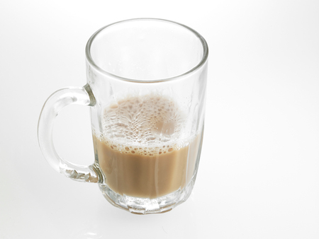Half glass of Tea with milk or Teh Tarik in Malaysia