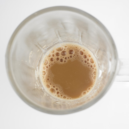 Top view of lnearly empth glass with little Tea with milk or Teh Tarik in Malaysia Reklamní fotografie