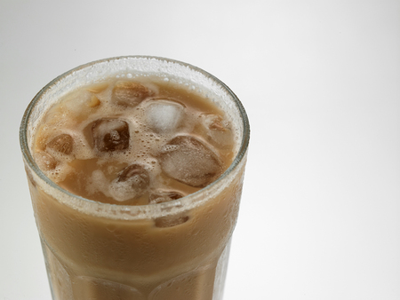 Top view milk tea with ice cube or teh tarik with ice