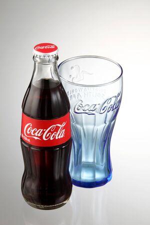 KUALA LUMPUR, MALAYSIA - june 6TH, 2015.coca cola bottle with empty glass