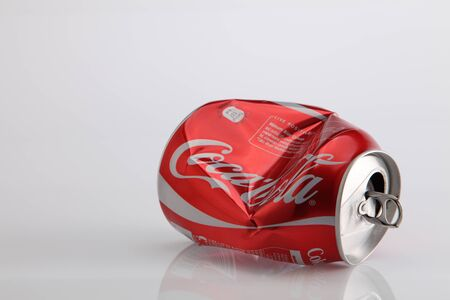 Kuala Lumpur,Malaysia.Jan 6, 2016 Crumpled Coca Cola can. Coca Cola drinks are produced and manufactured by The Coca-Cola Company