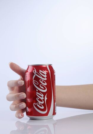 kuala lumpur-malaysia, 16th november 2015, female hand  about to grab a coca cola can drink