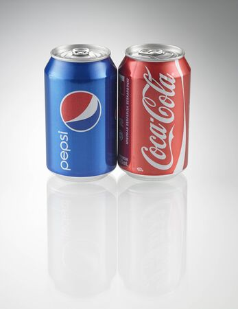 KUALA LUMPUR, MALAYSIA - July 2nd 2015,Coca-Cola and Pepsi cans on white background. Symbolic representation of one of the greatest business rivalries of all time.