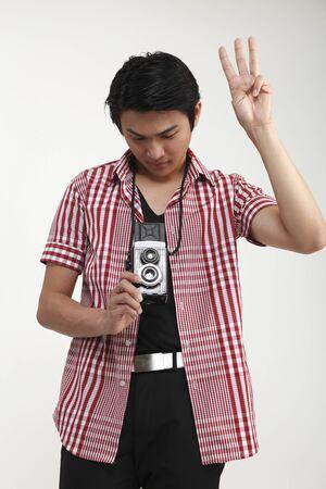 photographer holding a antique camera
