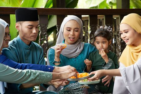 group of malay family breaking the fast together Stock fotó