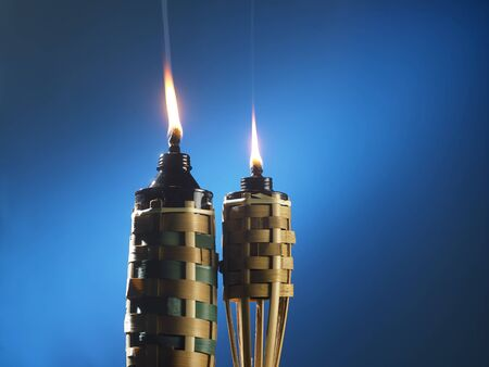 bamboo torch or pelita icon of hari raya on blue background