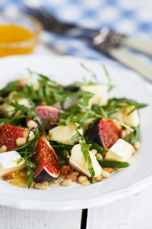 pinoli: Salad with figs, pine nuts,Camembert Cheese and honey.