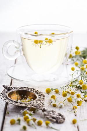 chamomile tea: Chamomile tea in a glass Cup