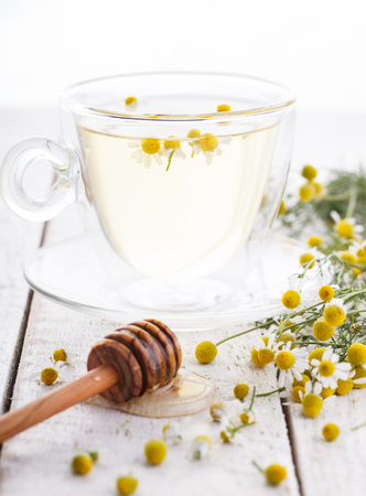 chamomile tea: Chamomile tea and honey in a glass Cup,therapeutic.selective focus