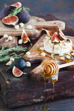 Baked Camembert with Figs,  hazelnuts and thyme.selective focus