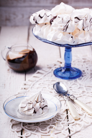cake stand: Meringue cookies on cake stand . Selective focus