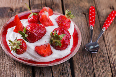 birthday background: Strawberries and cream. selective focus Stock Photo