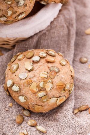 bran: Round sandwich bun with sunflower seeds from bran.