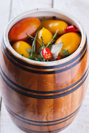 Marinated tomatoes in a barrel,home cooking.Appetizer.selective focus.