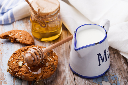 Oatmeal cookies with honey and milk.selective focus